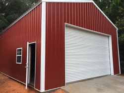 Pole barn with metal trusses