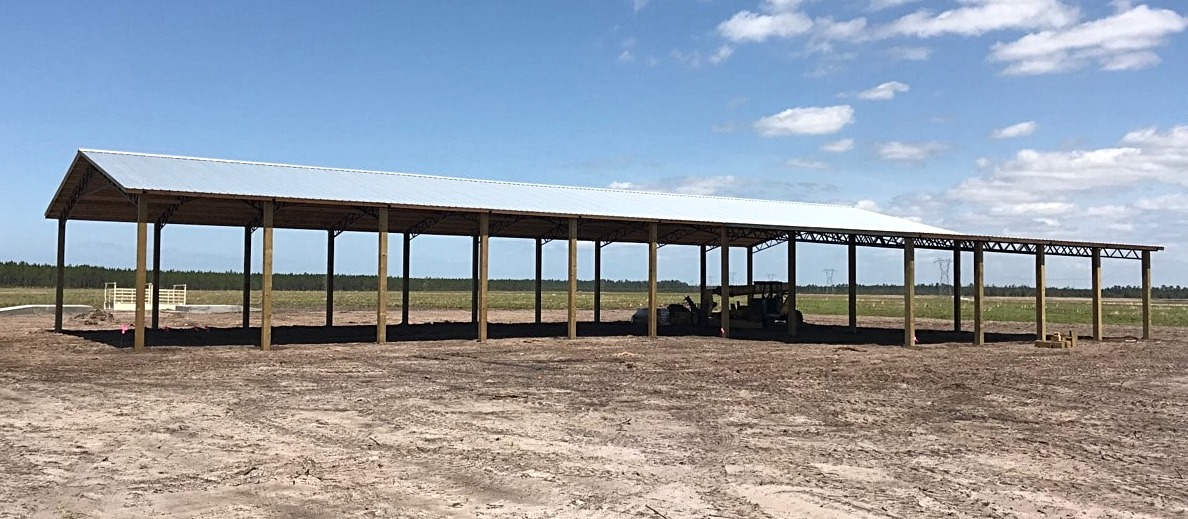 Pole barn kit with metal trusses