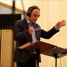 Stéphane_Orlando_conducting_DADA_1.png