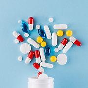 colorful-pills-plastic-bottle_23-2147983