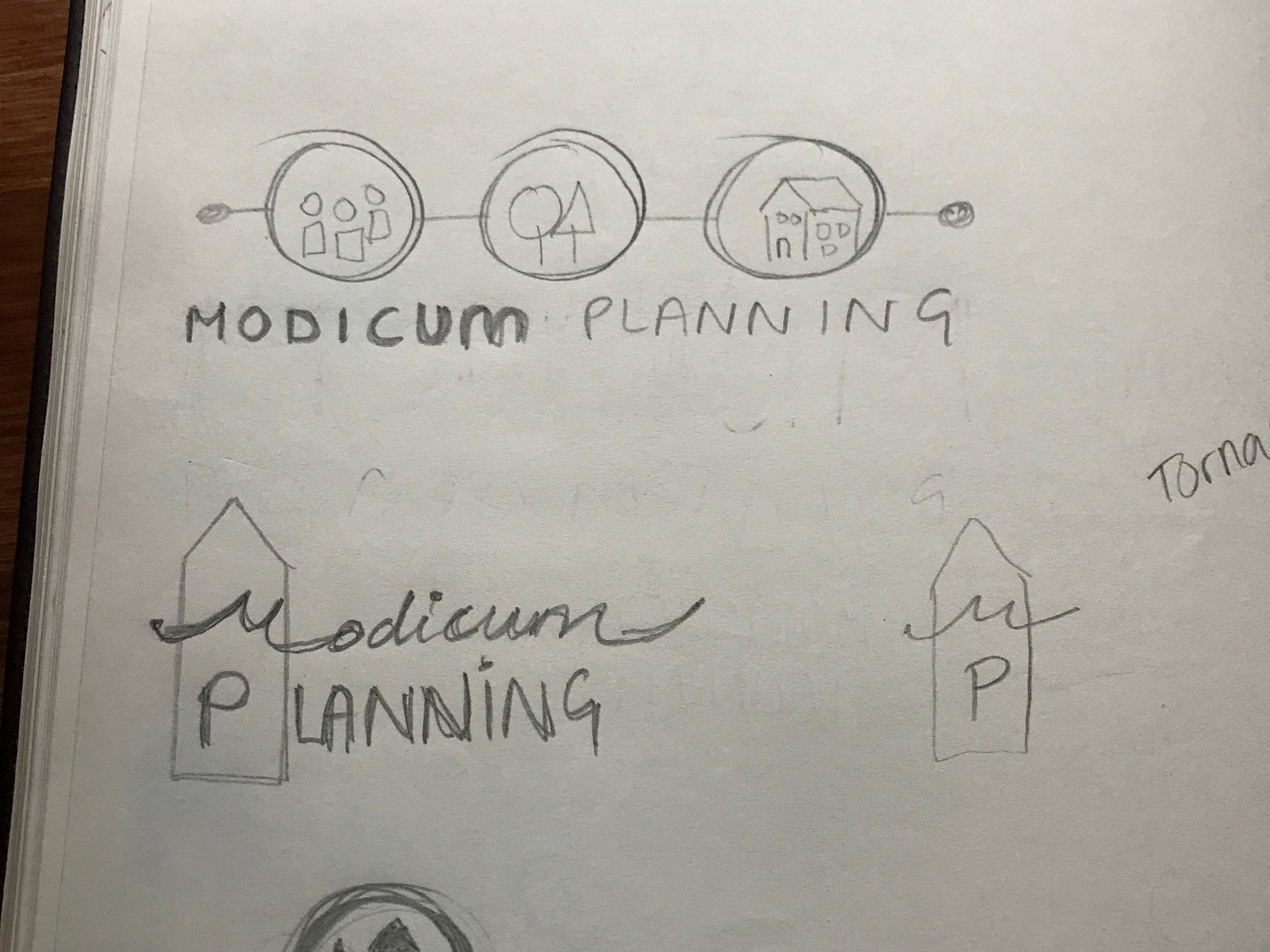 Early logo thumbnails in sketchbook
