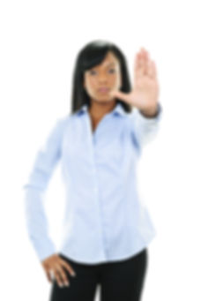 Serious black woman showing stop hand gesture isolated on white background