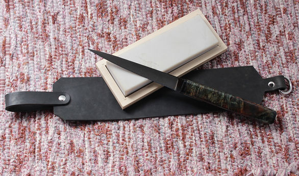 NHB carbon steel knife and strop Hand forged kitchen knives and tools. High quality stainless steel, carbon steel, damascus steel, copper ladles. Always American made. Knives for veggie prep.