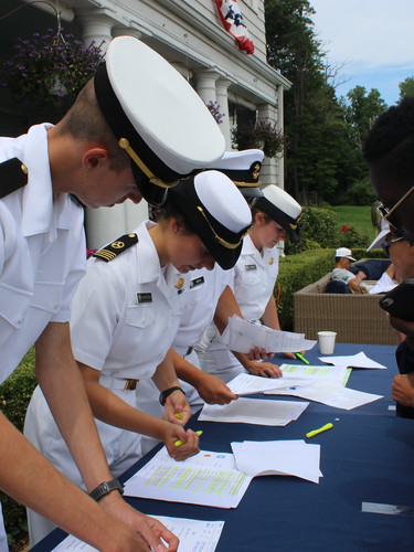 USMMA Cadets signing guests in