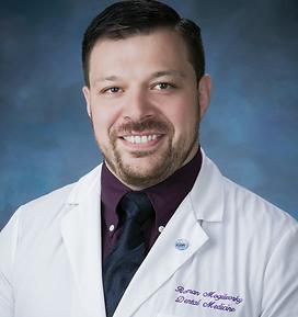 Dr Roman Headshot.heic