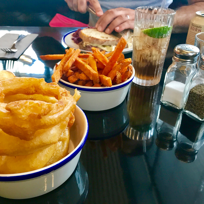 sides of onion rings and sweet potat