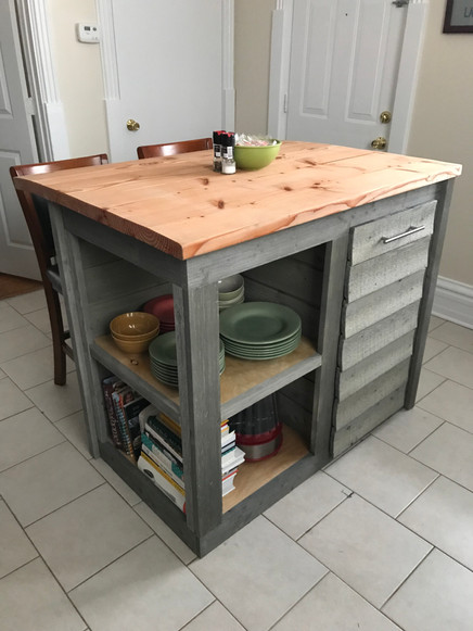 Custom kitchen island with butcher block top and shelving storage underneath