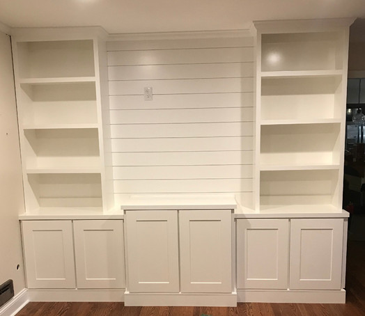 Custom built-in with shiplap backing and cabinets along the base