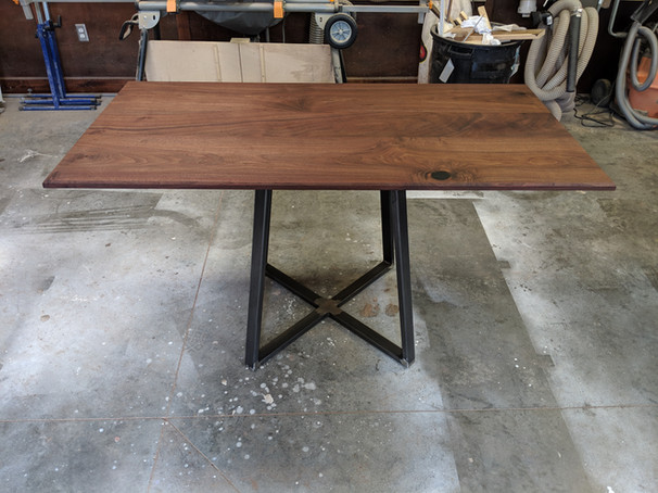 Contemporary style walnut table with metal base
