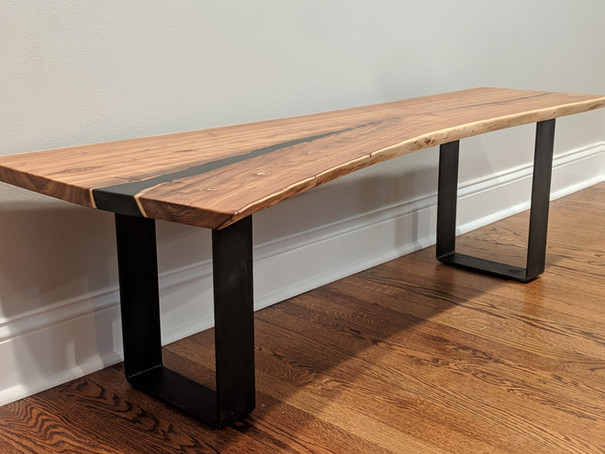 Elm bench with black resin pour and metal base