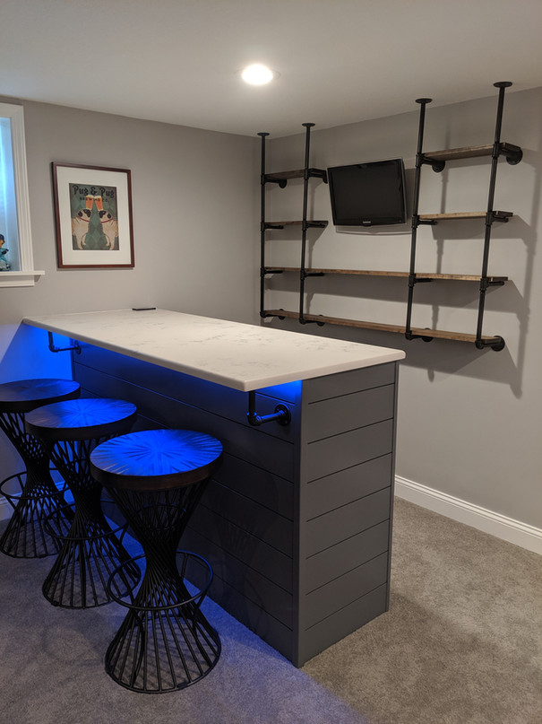 Custom-built bar with shiplap base and LED lighting
