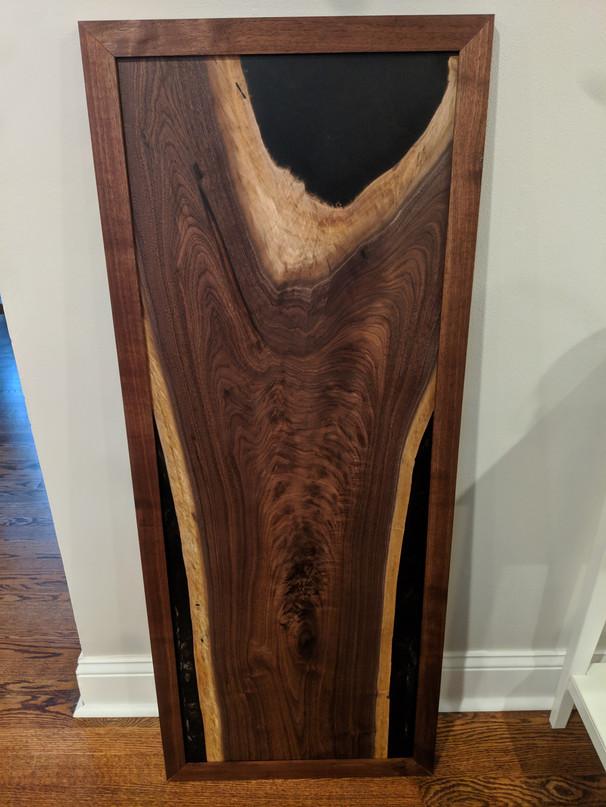 Walnut art piece with black resin pour
