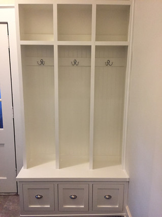 Custom mud room built-in with drawers and storage space