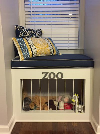 Custom window seat and zoo for child's room