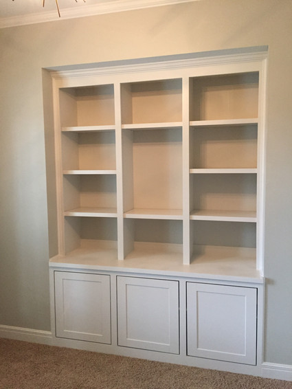 Custom built-in shelving and cabinet storage