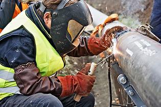 Man Welding Pipe for Pressure Testing