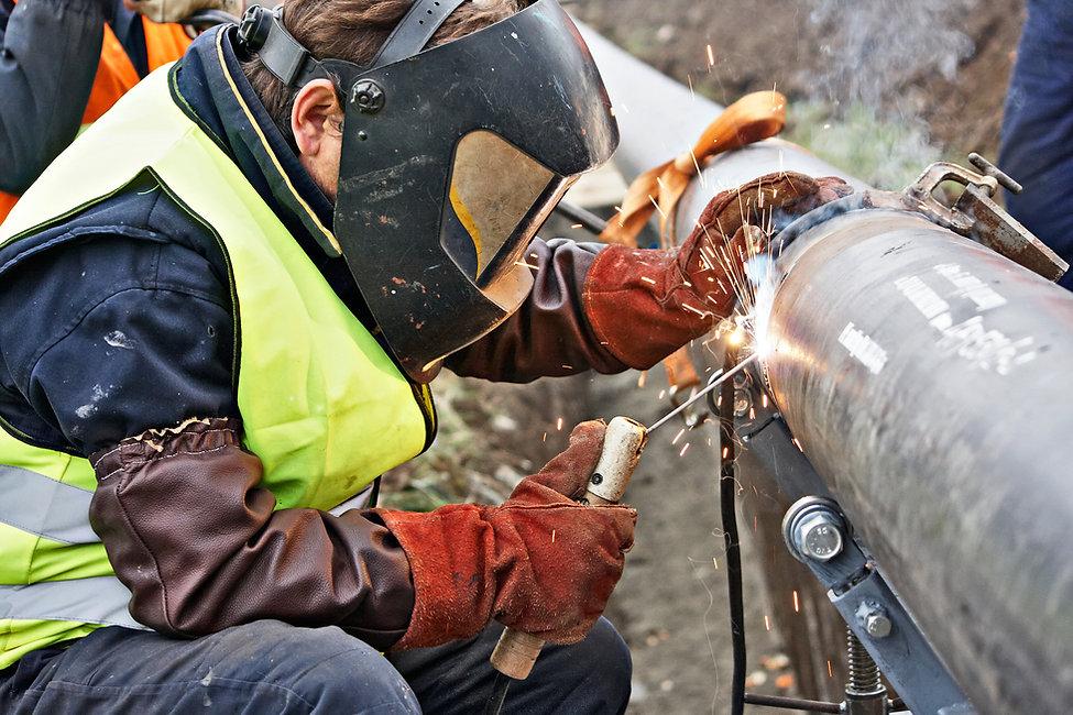 Man Fixing Pipe