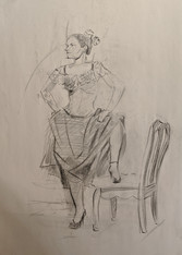 Dancer with foot on chair