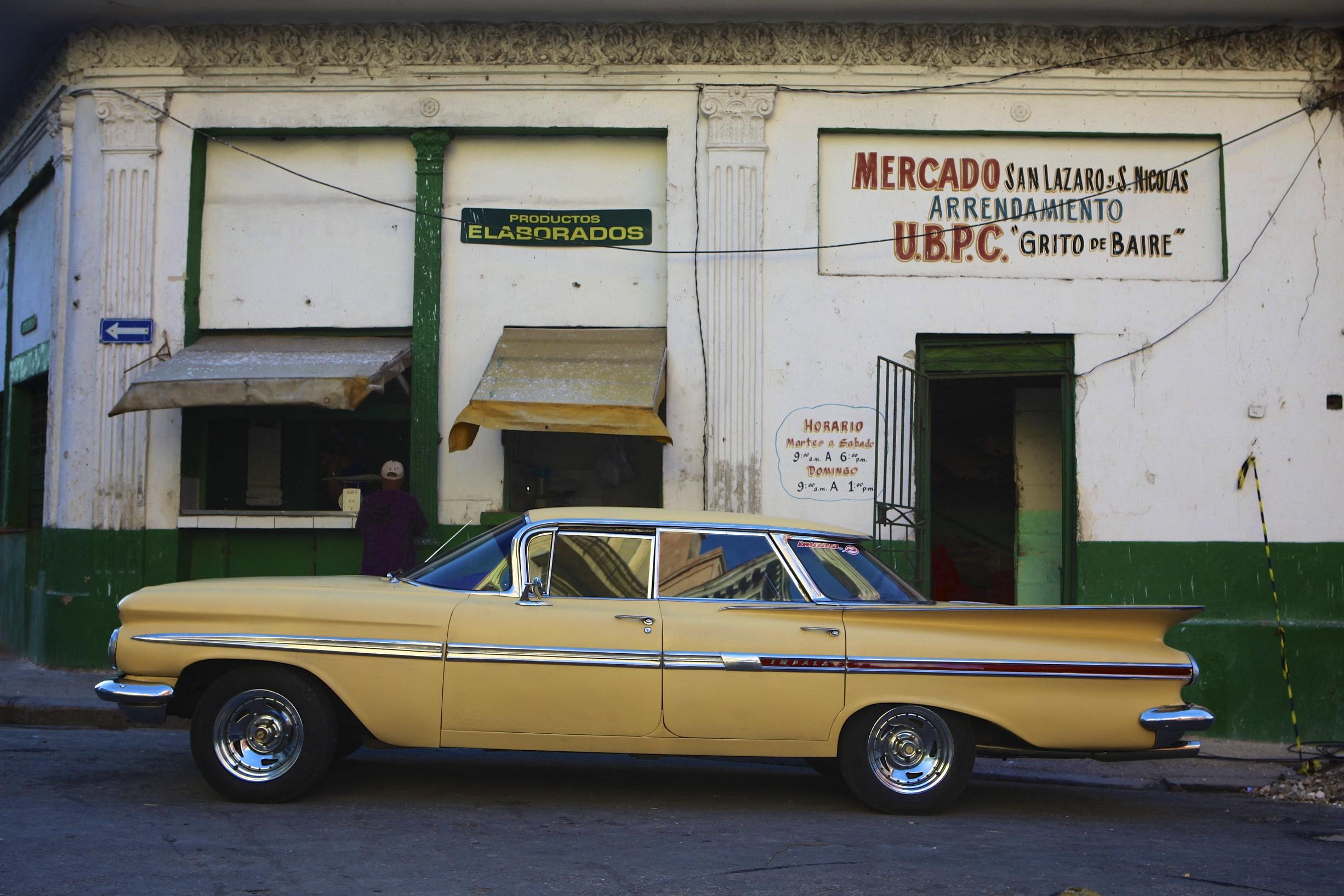Yellow Car at Mercado