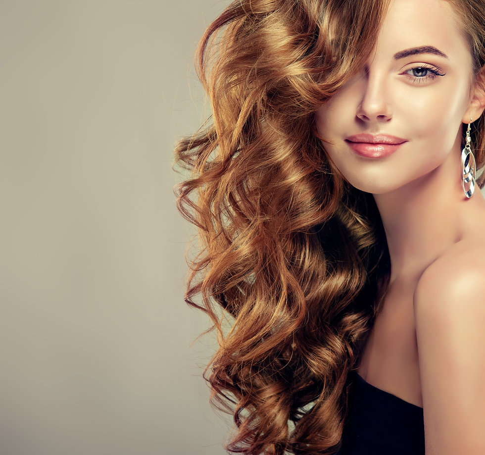 Beautiful girl with long wavy hair .  Br