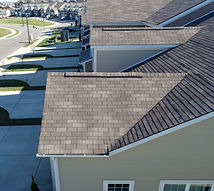 Looking down a row of townhouse roof lev