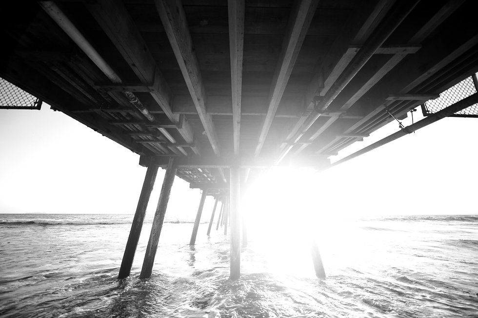 Sunrise below pier_edited.jpg