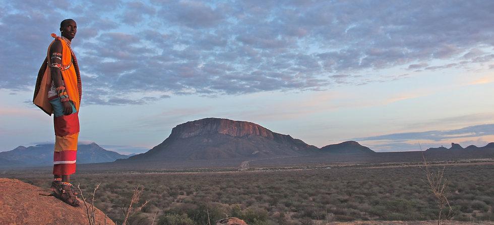 Samburu guide and Sacred Mountain.JPG