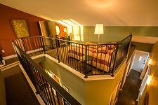 10_Fir Suite_Queen Bed on Loft Level.jpg