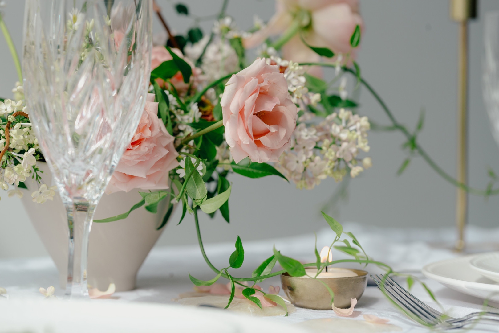 peach-roses-on-table-with-glass.jpg