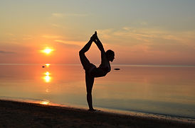 beach-yoga-pose-in-sand-at-sunset.jpg