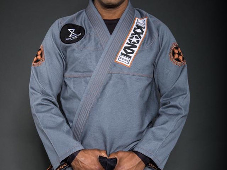 "Brazilian Jiu Jitsu Black Belt Jorge Santiago  in the KNOXX ""Manchira"" Gray Jiu Jitsu Gi"