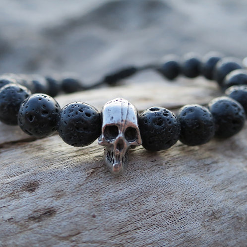 Raw lava stone and pewter skull