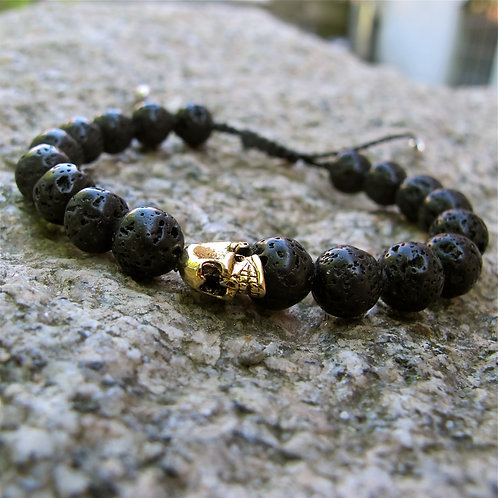 Lava stone and gold metal skull