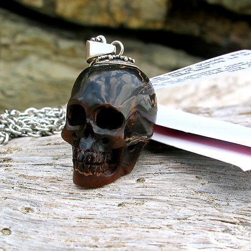 Eternal Life. A hand carved bone skull Necklace