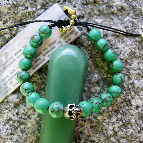 El salvadorian Green turquoise and metal skull