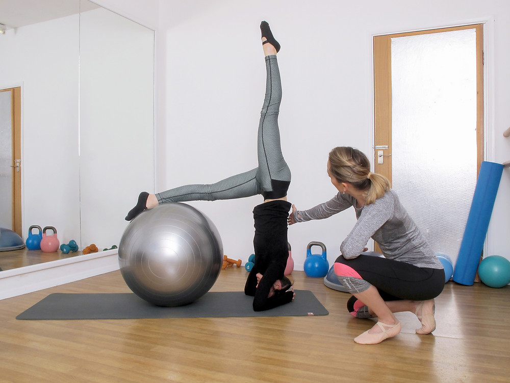 Swiss ball pike into headstand - showing us how it's done