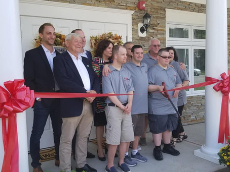 Ribbon Cutting Ceremony for the SMILE Home in the Colabella Building!