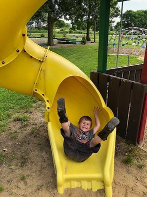 Boy in slide tube.jpeg