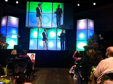 Glenn Thayer, Master of Ceremonies, on stage with Dr. Oz