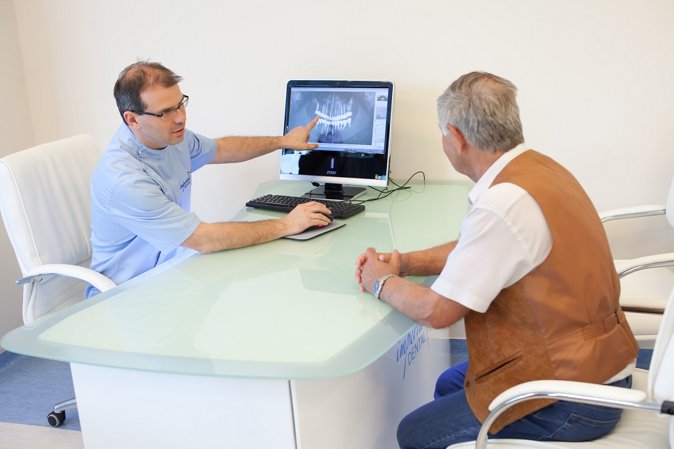 Imperial Implant Dentistry consultation with X-ray