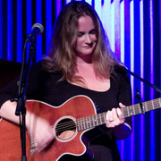 Lisa Piccirillo plays guitar