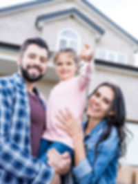 young family with keys moving into new h