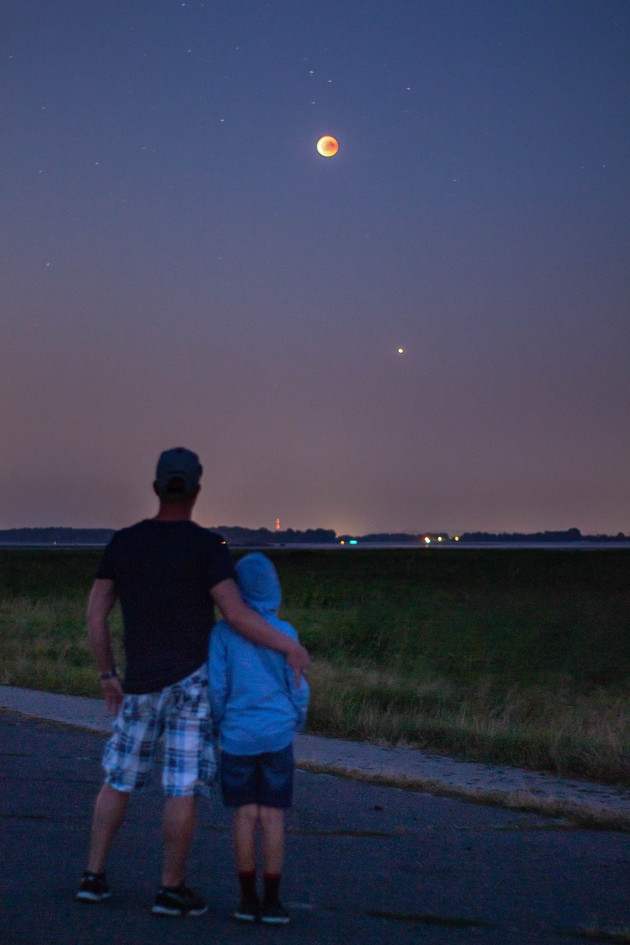 Father and son enjoy the lunareclipse