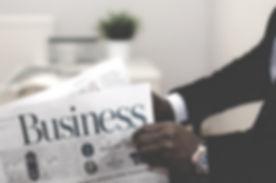 Businessman opening a paper_edited.jpg