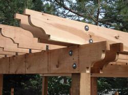 cedar pergola scallops with bridge washers and angle steel.jpg