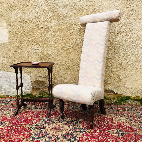 Upholstered prie-dieu chair.