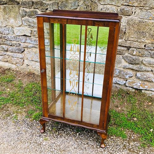 Mid20thCentury mirrorbacked glazed display cabinet