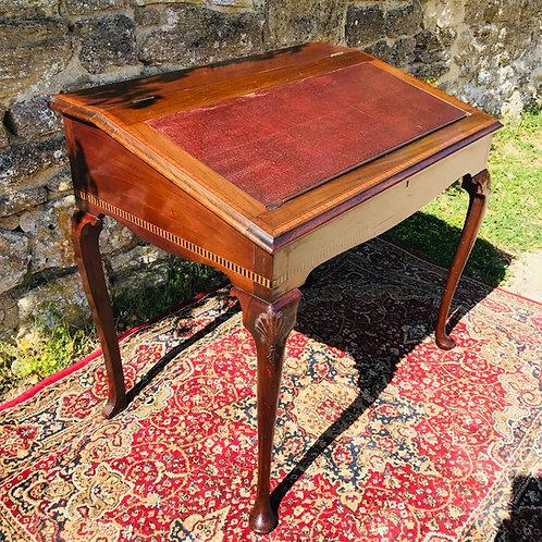 Edwardian Gentleman's writing table in cross-banded mahogany.