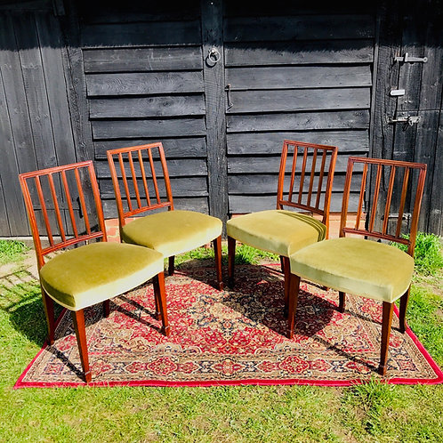 Set of four antique framed, upholstered dining chairs in mahogany.