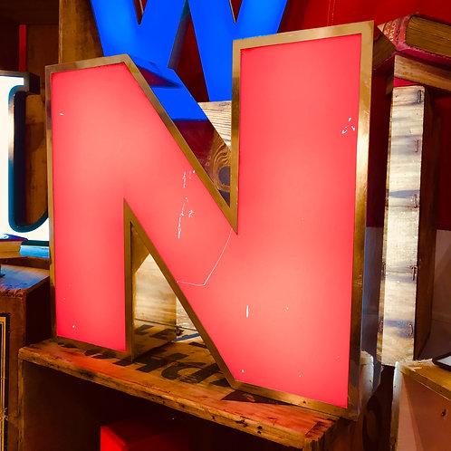 Salvaged illuminated shop letter - N